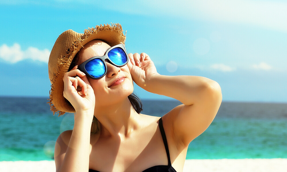 Woman on beach in sunglasses