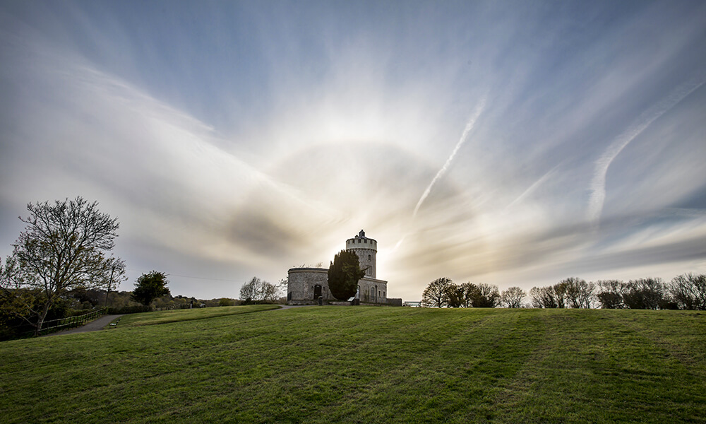 solar halo behind old castle